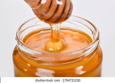 golden color healthy transparent honey in bottle