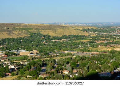 Golden, Colorado on a sunny day with the Denver skyline in the background.