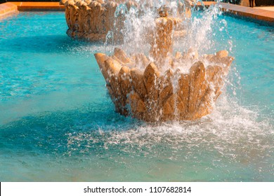 golden colored fountain and water jet