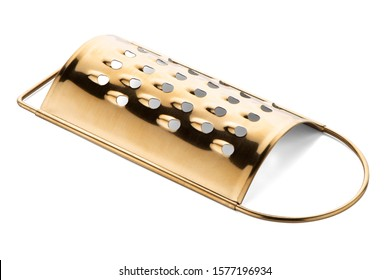 Golden colored metal scraper isolarted on white background.