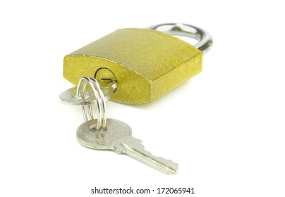A golden coloured padlock with keys on a white background