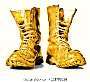 golden  combat boots isolated on white background