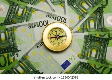 golden Compass lie in the center on 100 hundret euro bill background