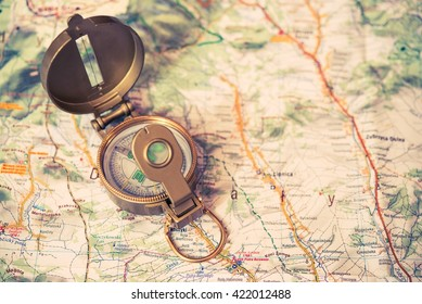 Golden Compass and the Map. Travel and Navigation Theme