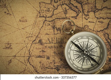 Golden compass on an old map. Selective focus