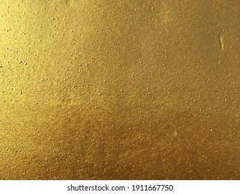 Golden concrete surface texture for abstract background