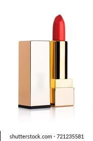 Golden container of luxury cosmetic red lipstick on white background