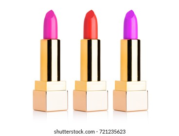 Golden containers of luxury cosmetic lipstick different colors on white background