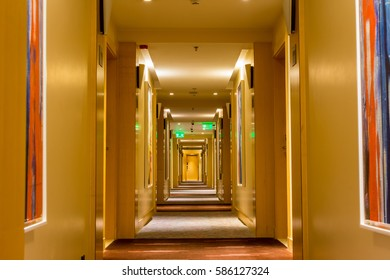 Golden corridor with carpet and closed doors at the hotel