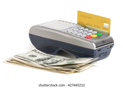 Golden credit card in card reader with pile of hundred dollar bills isolated on white background