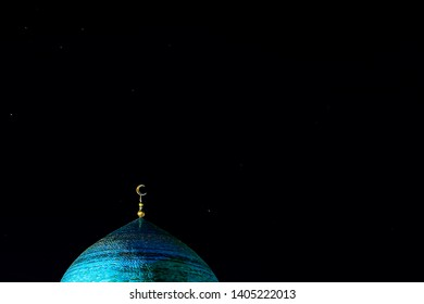The golden crescent on the dome of the Mosque. Waxing moon - a symbol of Islam at the top of the temple at night sky with stars. Copy space. For Ramadan and Eid background