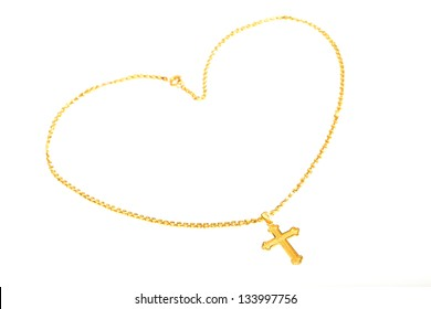 Golden cross necklace  display with love heart shape isolated on white background