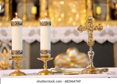 Golden cross on the altar with candles and empty place for text