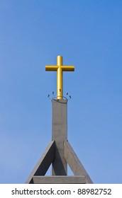 The golden cross on a blue sky