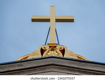 Golden cross on the top of a church