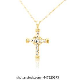 Golden cross pendant isolated on white