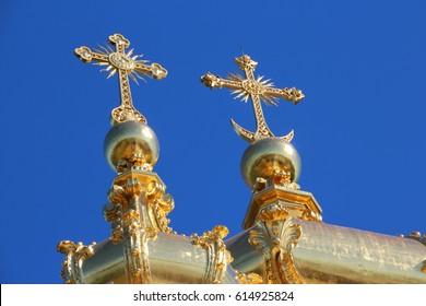 Golden crosses over the Church