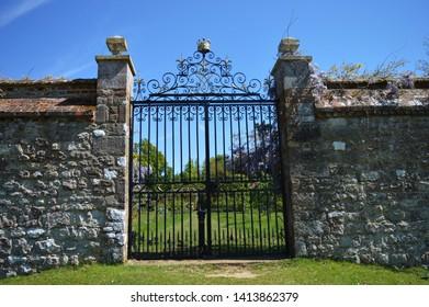 Golden crown on iron gates