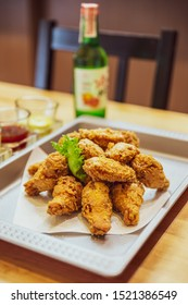 Golden Crunchy Korean Fried Chicken (basic Huraideu-Chikin) served with pickled and Soju. In South Korea, fried chicken is consumed as a meal, an appetizer, Anju, or as an after-meal snack.