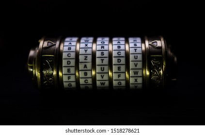 golden cryptex on dark background