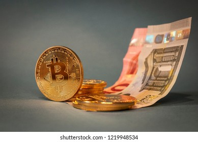 Golden cryptocurrency coins with 15 Euros on a pale blue background, featuring Bitcoin, Ethereum and Monero