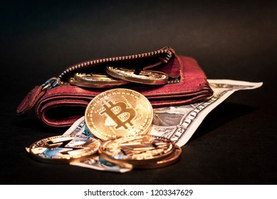 Golden cryptocurrency coins featuring Bitcoin, Monero & Ethereum with a dollar bill and leather wallet with black background