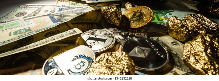 Golden cryptocurrencys bitcoin ethereum litecoin and mound of gold business concept image