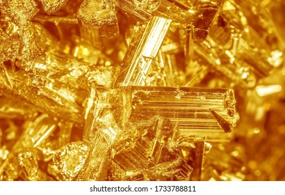 Golden crystal mineral stone. Gems. Mineral crystals in the natural environment. Texture of precious and semiprecious stones. Seamless background with copy space.