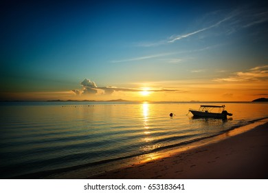 Golden dawn over the beach silhouette speed boat .Rawa island , Malaysia . Selected focus on center . - Shutterstock ID 653183641