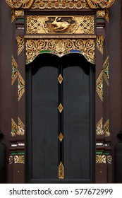 Golden decorated door of a buddhist temple in Thailand