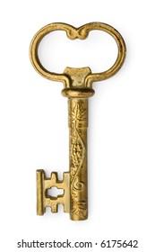 a golden decorative vintage key on white