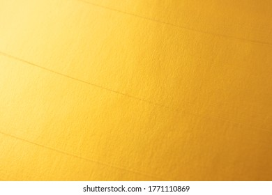 Golden defocused bright textured backgound. Elegant and luxury gold color abstract wallpaper