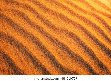 Golden desert sand during sunset as background
