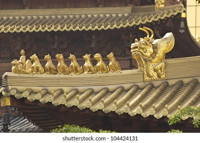 Golden details on the roof of the Buddhist Jing'an temple in Shanghai, China.