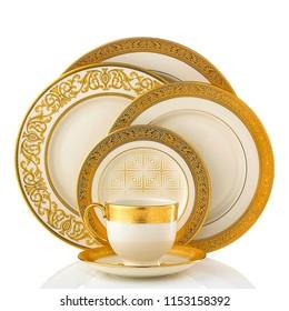 Golden dinner set, Cookware set on white background, Golden dishware set, Golden teacup set