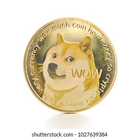 The golden dogecoin isolated on white background.