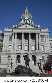 Golden dome of the Colorado state capitol in Denver on a sunny summer morning.