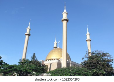 The golden dome and four minaret towers of the Abuja National Mosque, also known as the Nigerian National Mosque, the national mosque of Nigeria, in the capital Abuja.