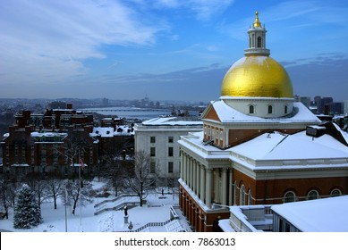 the golden dome of the massachusetts state house covered with snow after a winter storm is striking in this dramatic image