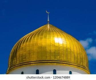 The golden dome of the Nur-Astana Mosque in Astana, Kazakhstan
