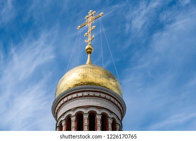 Golden dome with orthodox cross of beautiful church in Yoshkar-Ola city, Russia. Spiritual refuge for people.