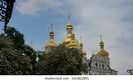 Golden domes of the Assumption Cathedral in Kiev Pechersk Lavra against the background of clouds