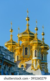 Golden domes of a Christian Church in Tsarskoye Selo on the background of blue sky