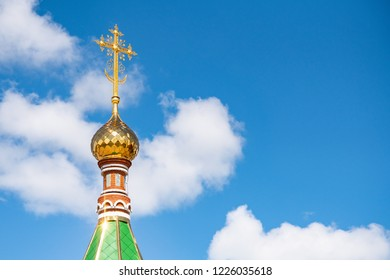 Golden domes and cross of beautiful orthodox church in Yoshkar-Ola city, Russia. Spiritual refuge for people. Copy space