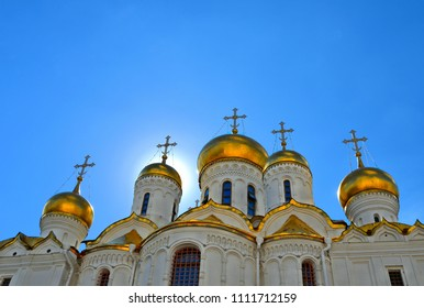 Golden domes and cross of historical old Annunciation Cathedral in Moscow Kremlin, Russia