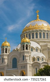 Golden domes of Kronstadt Naval Cathedral (also known as the Naval cathedral of Saint Nicholas in Kronstadt). St.Petersburg. Russia. Russian Orthodox cathedral built in 1903-1913. Summer sunny day
