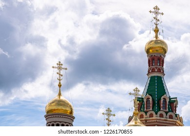 Golden domes and orthodox crosses of beautiful church in Yoshkar-Ola city, Russia. Spiritual refuge for people.