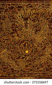Golden dragon carved on marble.