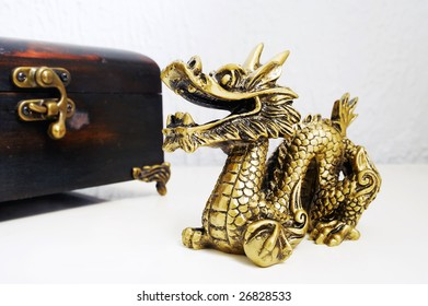 Golden dragon figurine on the table