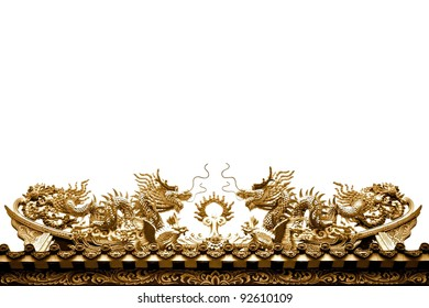Golden dragon sculpture on the roof isolated on white background